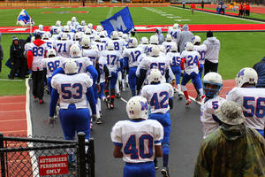 Photo - HIGH SCHOOL FOOTBALL PLAYOFFS: The Millwood Falcons take the field before the Class 2A semifinals between Millwood and Hennessey in Yukon, Saturday, December 3 2011. PHOTO BY HUGH SCOTT, FOR THE OKLAHOMAN ORG XMIT: KOD