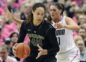 Photo - Baylor's Brittney Griner, left, is pressured by Connecticut's Stefanie Dolson during the first half of an NCAA college basketball game in Hartford, Conn., Monday, Feb. 18, 2013. (AP Photo/Jessica Hill)