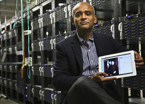Photo - FILE - In this Thursday, Dec. 20, 2012, file photo, Chet Kanojia, founder and CEO of television-over-the-Internet service Aereo, Inc., shows a tablet displaying his company's technology, in New York. After the Supreme Court's ruling against the company, Aereo is now using the high court's own language to force broadcasters to treat it just like other cable TV companies. In Aereo's view, that means broadcasters must license its signals to Aereo under a 1976 copyright law. (AP Photo/Bebeto Matthews, File)