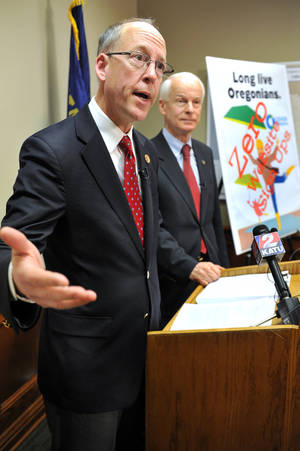 Photo - U.S. Rep Greg Walden, R-Ore., announces Thursday, Feb. 13, 2014 that he and other Republican House lmembers have called on the General Accounting Office to investigate how $304 million in federal grants was spent on the troubled Cover Oregon online enrollment system for the federal health insurance overhaul. With him is state Rep. Dennis Richardson, who is running for governor. (AP Photo/Bob Pennell/Mail Tribune) (AP Photo/The Medford Mail Tribune, )