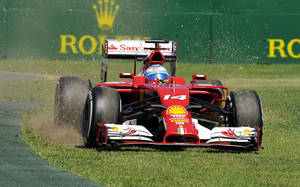 Photo - Ferrari driver Fernando Alonso of Spain goes off the track on turn one during the first practice session for the Australian Formula One Grand Prix at Albert Park in Melbourne, Australia, Friday, March 14, 2014. (AP Photo/Andy Brownbill)