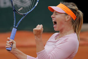 Photo - Russia's Maria Sharapova reacts as she plays Australia's Samantha Stosur during their fourth round match of  the French Open tennis tournament at the Roland Garros stadium, in Paris, France, Sunday, June 1, 2014. (AP Photo/Michel Spingler)