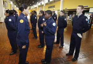 Photo - Cadet Staff Sgt. Desiree Shaw, left, conducts inspection during class time for the Midwest City High School JROTC.
