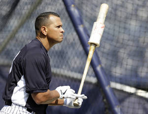 Photo - New York Yankees Alex Rodriguez, who is the only player appealing his suspension for using PED's, stands by the batting cage during batting practice before a baseball game Sunday, Aug. 11, 2013, in New York. (AP Photo/Kathy Willens)
