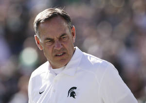 Photo - Michigan State coach Mark Dantonio watches his players before the Rose Bowl NCAA college football game against Stanford on Wednesday, Jan. 1, 2014, in Pasadena, Calif. (AP Photo/Jae C. Hong)