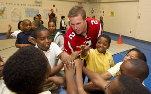Photo -   Atlanta Falcons quarterback Matt Ryan (2) plays with student at Clifton elementary School in Atlanta, Tuesday, Oct. 9, 2012. Several Falcons spent the morning visiting area schools as part of the NFL's Hometown Huddle volunteer program. (AP (AP Photo/John Bazemore)