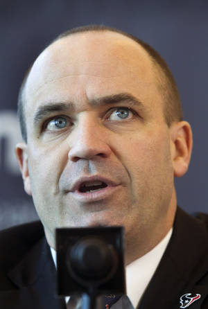 Photo - Former Penn State head coach and New England Patriots offensive coordinator Bill O'Brien speaks during a press conference where he was introduced as the new head coach of the Houston Texans NFL football team, Friday, Jan. 3, 2014, in Houston. (AP Photo/Patric Schneider)