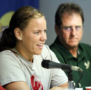 photo - Oklahoma's Keilani Ricketts, left, speaks as South Florida coach Ken Eriksen looks on Wednesday. Eriksen compared Ricketts to Babe Ruth because of her pitching and hitting dominance. Photo by Nate Billings, The Oklahoman
