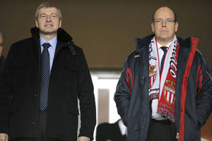Photo - FILE - A Sunday, Jan. 26 , 2014 from files showing President of AS Monaco Dmitry Rybolovlev, left, and Prince Albert II Of Monaco, as they attend the French League One soccer match Monaco vs Marseille, in Monaco stadium. A Swiss court has ordered Russian billionaire Dmitry Rybolovlev to pay $4.5 billion to his ex-wife, in what could end up being the biggest divorce settlement in history. In papers delivered to the parties Monday, May 19, 2014, the Geneva Tribunal of First Instance said the 47-year-old Rybolovlev, a co-owner of the French soccer club AS Monaco, must pay 4,020,555,987.80 Swiss francs ($4,509,375,184.80) to ex-wife Elena Rybolovleva, also 47, of Geneva. The judgment shows that his wife also won two pieces of real estate in the ultra-wealthy area of Geneva known as Cologny, where the couple once lived together, and confirmed her custody of their 13-year-old daughter Anna. They also have an older daughter, Ekaterina, after meeting as university students in Perm, Russia, and marrying there in 1987. The divorce case began in 2008, when Forbes estimated his worth at $12.8 billion. (AP Photo/Lionel Cironneau)