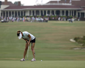 Photo - Michelle Wie putts on the first hole during a practice round for the U.S. Women's Open golf tournament in Pinehurst, N.C., Wednesday, June 18, 2014. (AP Photo/Chuck Burton)