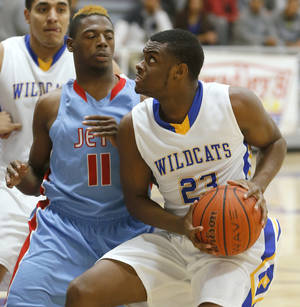 Photo - Piedmont's Cameron Peters tries to get past Western Heights' Gerard Giles during their high school basketball game in the Bethany Classic tournament in Bethany, Okla., Friday, Jan. 10, 2014. Photo by Bryan Terry, The Oklahoman
