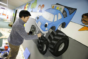 "Photo - Shikoh Shiraiwa with Palmer Studios paints a racetrack-theme mural  inside Oakcrest Church of Christ, 1111 SW 89, in conjunction with the church's children ministry the ""Starting Line KIds.""  <strong>PAUL B. SOUTHERLAND - PAUL B. SOUTHERLAND</strong>"