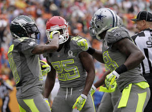 Photo - Philadelphia Eagles DeSean Jackson (10) of Team Sanders celebrates with teammates Kansas City Chiefs running back Jamaal Charles (25) and Dallas Cowboys wider receiver Dez Bryant (88) after Jackson caught a pass for a touchdown in the first half  during the Pro Bowl, Sunday, Jan. 26, 2014, at Aloha Stadium in Honolulu. (AP Photo/Eugene Tanner)
