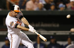Photo -   Baltimore Orioles' J.J. Hardy hits a two-run home run in the third inning of a baseball game against the Tampa Bay Rays in Baltimore, Tuesday, Sept. 11, 2012. (AP Photo/Patrick Semansky)