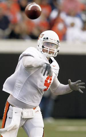 photo - OSU's Brandon Weeden will have to wait to find out if he will back up quarterback Zac Robinson.  Photo by nate billings, the oklahoman