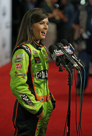photo - Auto racing driver Danica Patrick speaks with reporters during NASCAR media day at Daytona International Speedway, Thursday, Feb. 14, 2013, in Daytona Beach, Fla. (AP Photo/John Raoux)