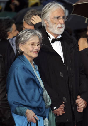 Photo -   Director Michael Haneke, right, and actress Emmanuelle Riva arrive for the awards ceremony at the 65th international film festival, in Cannes, southern France, Sunday, May 27, 2012. (AP Photo/Joel Ryan)