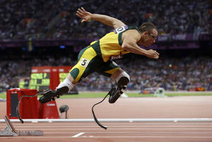 Photo - FILE - In this Aug.  5, 2012 file photo, South Africa's Oscar Pistorius starts in the men's 400-meter semifinal during the athletics in the Olympic Stadium at the 2012 Summer Olympics in London. Paralympic superstar Oscar Pistorius was charged Thursday, Feb. 14, 2013, with the murder of his girlfriend who was shot inside his home in South Africa, a stunning development in the life of a national hero known as the Blade Runner for his high-tech artificial legs.  Reeva Steenkamp, a model who spoke out on Twitter against rape and abuse of women, was shot four times in the predawn hours in the home, in a gated community in the capital, Pretoria, police said. (AP Photo/Anja Niedringhaus, File)