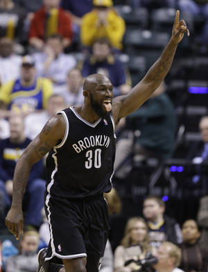 photo - Brooklyn Nets forward Reggie Evans celebrates a tip-in basket in the final 45 seconds of overtime against the Indiana Pacers in an NBA basketball game in Indianapolis, Monday, Feb. 11, 2013. The Nets defeated the Pacers 89-84 in overtime. (AP Photo/Michael Conroy)