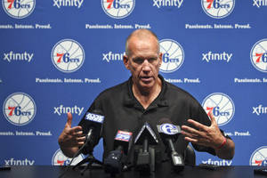 photo -   Philadelphia 76ers coach Doug Collins gestures during an NBA basketball news conference, Tuesday, July 17, 2012, in Philadelphia. (AP Photo/Brynn Anderson)