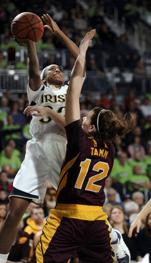 Photo - Notre Dame guard Jewell Loyd, left, drives the lane as Central Michigan guard Kerby Tamm defends during the second half of an NCAA college basketball game, Sunday, Dec. 22, 2013, in South Bend, Ind. (AP Photo/Joe Raymond)