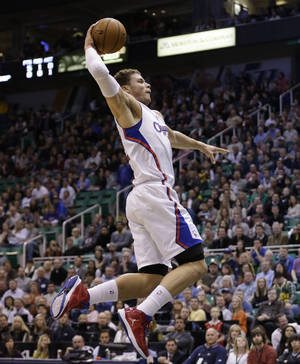 photo - Los Angeles Clippers power forward Blake Griffin (32) dunks the ball in the first quarter of an NBA basketball game against the Utah Jazz, Friday, Dec. 28, 2012, in Salt Lake City. (AP Photo/Rick Bowmer)