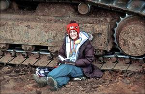 photo - Norman resident Elisabeth Leja chained herself to a track hoe Monday morning to protest the transportation of diluted bitumen from Canada's oil sands. She subsequently was arrested in the incident. Photo provided