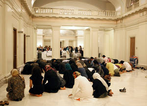 Photo - A group prays during the 2011 Capitol Interfaith Iftar dinner at the state Capitol in Oklahoma City. The dinner was held during Ramadan, the Islamic holy month of fasting which this year begins on Friday, July 20. , <strong>SARAH PHIPPS - SARAH PHIPPS</strong>