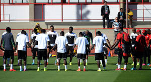 Photo - Ghana players pause,  prior to a training session in Brasilia, Brazil, Wednesday, June 25, 2014. Ghana will play Portugal in group G of the 2014 soccer World Cup on June 26. (AP Photo/Paulo Duarte)