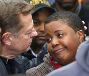 Photo - FILE-- In this Wednesday, Jan. 30, 2013 photo, Father Michael Pfleger , left, consoles Cleopatra Pendleton during a news conference where Chicago Police Superintendent Garry McCarthy was seeking help from the public in solving the murder of Pendleton's daughter Hadiya in Chicago. Police say they are receiving many tips as they investigate last week's shooting death of Pendleton. But there is also a concern that people with valuable information may not be coming forward and others wonder if people are staying silent out of concern that talking might put their own lives in danger. (AP Photo/Charles Rex Arbogast-FILE)