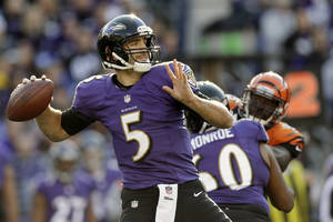 Photo - Baltimore Ravens quarterback Joe Flacco passes the ball during the first half of a NFL football game against the Cincinnati Bengals in Baltimore, Sunday, Nov. 10, 2013. (AP Photo/Patrick Semansky)