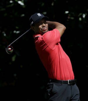 Photo - Tiger Woods tees off the fourth hole during the final round of play in the Tour Championship golf tournament at East Lake Golf Club, in Atlanta, Sunday, Sept. 22, 2013. (AP Photo/John Bazemore)