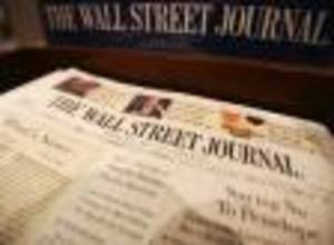 Photo - FILE - In this May 1, 2007 file photo, copies of The Wall Street Journal sit on a New York newsstand on Tuesday, May 1, 2007. The Guardian newspaper on Wednesday, Oct. 12, 2011 reported that it had seen emails and documents showing that The Wall Street Journal funneled money through third parties to a company that was buying up copies of the Journal and boosting its European circulation. (AP Photo/Mark Lennihan, File)