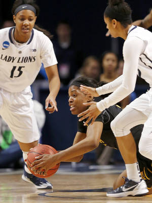 Photo - Wichita State's Michelle Price, center, dives for the ball in front of Penn State's Kaliyah Mitchell (15) during the first half in a first-round game in the NCAA college basketball tournament on Sunday, March 23, 2014, in State College, Pa. (AP Photo/Keith Srakocic)