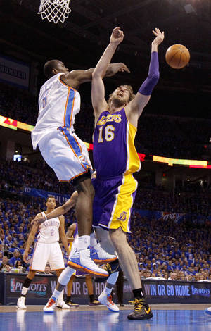 Photo - Oklahoma City's Serge Ibaka (9) blocks the shot of Los Angeles' Pau Gasol (16) during Game 5 in the second round of the NBA playoffs between the Oklahoma City Thunder and the L.A. Lakers at Chesapeake Energy Arena in Oklahoma City, Monday, May 21, 2012. Photo by Bryan Terry, The Oklahoman <strong>BRYAN TERRY</strong>