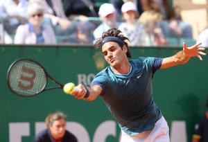 Photo - Roger Federer of Switzerland returns the ball to Novak Djokovic of Serbia, during their semifinal match of the Monte Carlo Tennis Masters tournament in Monaco, Saturday, April, 19, 2014. Federer won 7-6, 6-2. (AP Photo/Claude Paris)