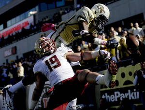 photo -   A pass intended for Georgia Tech wide receiver Jeff Greene, right, is broken up by Boston College defensive back Sean Sylvia during the second quarter of an NCAA college football game, Saturday, Oct. 20, 2012, in Atlanta. (AP Photo/David Goldman)
