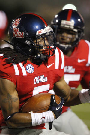 Photo -   Mississippi defensive back Frank Crawford (5) spins around after intercepting a Central Arkansas fourth quarter pass in their NCAA college football game in Oxford, Miss., Saturday, Sept. 1, 2012. Mississippi won 49-27. (AP Photo/Rogelio V. Solis)