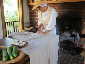 Photo - At Historic Pensacola Village, a woman demonstrates how clothing was made during Florida's colonial era. PHOTO BY WESLEY K.H. TEO, FOR THE OKLAHOMAN <strong></strong>