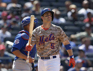 Photo - New York Mets' David Wright reacts after he struck out swinging in the ninth inning of the Mets 4-1 loss to the Chicago Cubs in a baseball game at Citi Field in New York, Monday, Aug. 18, 2014. (AP Photo/Kathy Willens)