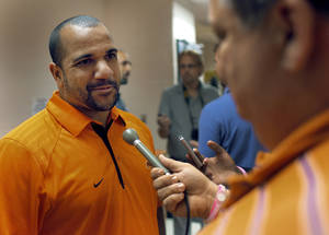 Photo - NEW OSU ASSISTANT COLLEGE FOOTBALL COACHES: Oklahoma State University new assistant coach Jemal Singleton addresses the media during a press conference at Gallagher-Iba Arena on Monday, Feb. 14, 2011, Stillwater, Okla.  Photo by Chris Landsberger, The Oklahoman ORG XMIT: KOD