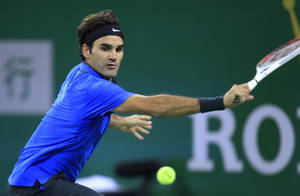 photo -   Roger Federer of Switzerland returns the ball against his compatriot Stanislas Wawrinka during the third round match of the Shanghai Masters tennis tournament at Qizhong Forest Sports City Tennis Center in Shanghai, China, Thursday, Oct. 11, 2012. Federer won 4-6 7-6(4), 6-0. (AP Photo/Eugene Hoshiko)