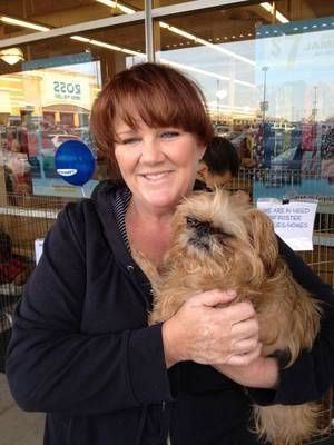Photo -  Crystal Maib, founder of Orphaned Angels Rescue, holds Ada, a dog in her rescue program. Photo provided  <strong></strong>