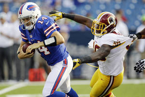 Photo -   Buffalo Bills quarterback Ryan Fitzpatrick (14) is pressured by Washington Redskins linebacker Brian Orakpo (98) during the first quarter of a preseason NFL football game in Orchard Park, N.Y., Thursday, Aug. 9, 2012. (AP Photo/David Duprey)