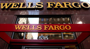 Photo -   FILE - In this May 6, 2012, file photo, a Wells Fargo sign is displayed at a branch in New York. Wells Fargo is reporting higher earnings and revenue for the third quarter, thanks to higher fees a rise in trading revenue. (AP Photo/CX Matiash, File)
