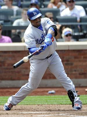 Photo -   Los Angeles Dodgers' Juan Uribe hits a two-run double off of New York Mets' Miguel Batista in the third inning of a baseball game on Saturday, July 21, 2012, at Citi Field in New York. (AP Photo/Kathy Kmonicek)