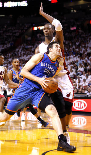 Photo - Oklahoma City's Nick Collison (4) drives to the baskets as Miami's Chris Bosh (1) defends during Game 4 of the NBA Finals between the Oklahoma City Thunder and the Miami Heat at American Airlines Arena, Tuesday, June 19, 2012. Photo by Bryan Terry, The Oklahoman