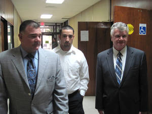 """Photo - FILE - In this Oct. 22, 2010, file photo, former Winnfield Police Officer Scott Nugent, center, walks with his attorneys Phillip Terrell, left and George Higgins in the Winn Parish Courthouse in Winnfield, La. Nugent was acquitted by a jury in 2010 of manslaughter in the Taser death of Baron """"Scooter"""" Pikes. The Supreme Court could take its first look at police use of Taser stun guns in a case involving the death of Pikes who was shocked by police eight times after he had been placed in handcuffs. The justices could say as early as Monday, May 19, 2014, whether they will add the case of Pikes to their fall calendar. The court is being asked to review a federal appeals court ruling that dismissed a civil rights lawsuit filed on behalf of Pikes' young son against the former police officer. (AP Photo/The Daily Town Talk, Billy Gunn, File)  NO SALES"""