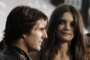 "Photo - Katie Holmes, right, and Tom Cruise arrive at the premiere of ""The Kennedys"" on March 28, 2011, at The Academy of Motion Pictures Arts and Sciences in Beverly Hills, Calif. Cruise and Holmes are calling it quits after five years of marriage. AP Photo <strong>Matt Sayles</strong>"