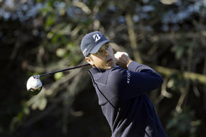 Photo - Matt Kuchar drives on the 11th tee during the first round of the Northern Trust Open golf tournament at Riviera Country Club in the Pacific Palisades area of Los Angeles Thursday, Feb. 14, 2013. (AP Photo/Reed Saxon)